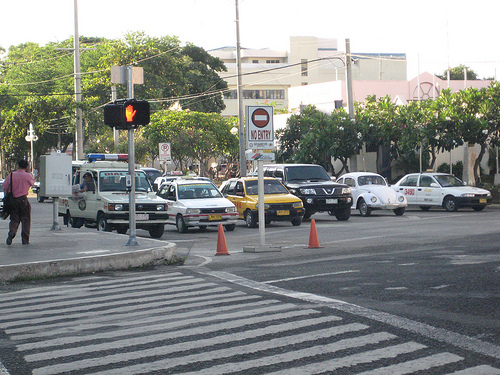 Vehicles waiting for the green light in Roxas Street Davao City