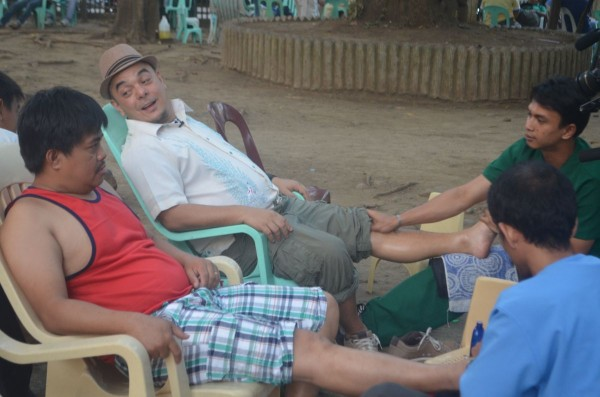 After all long day of walking, Celdran indulges in a quick foot massage at the park under the shade of the trees.