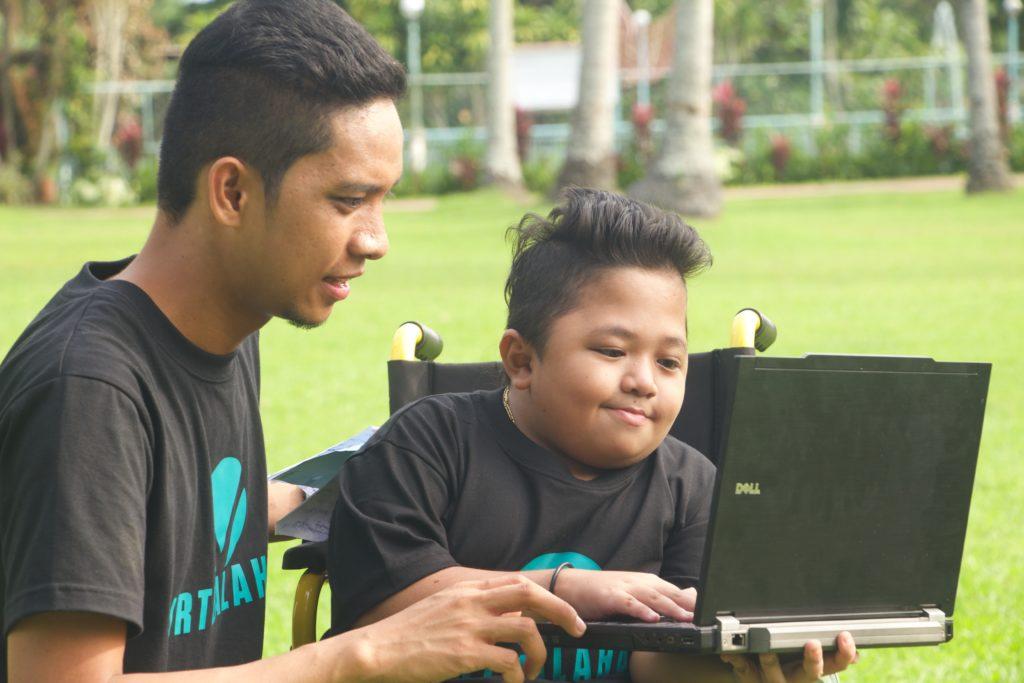 Virtualahan founder Ryan Dawa Gersava with one of the group's beneficiaries