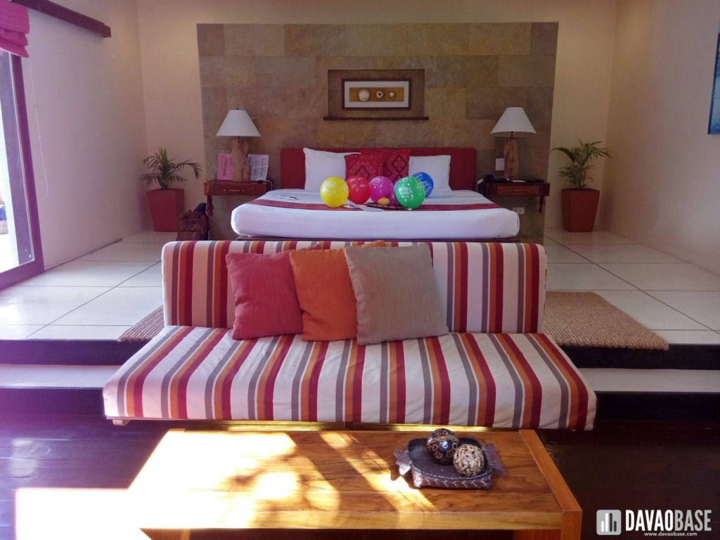bluewater panglao one bedroom villa king size bed living room