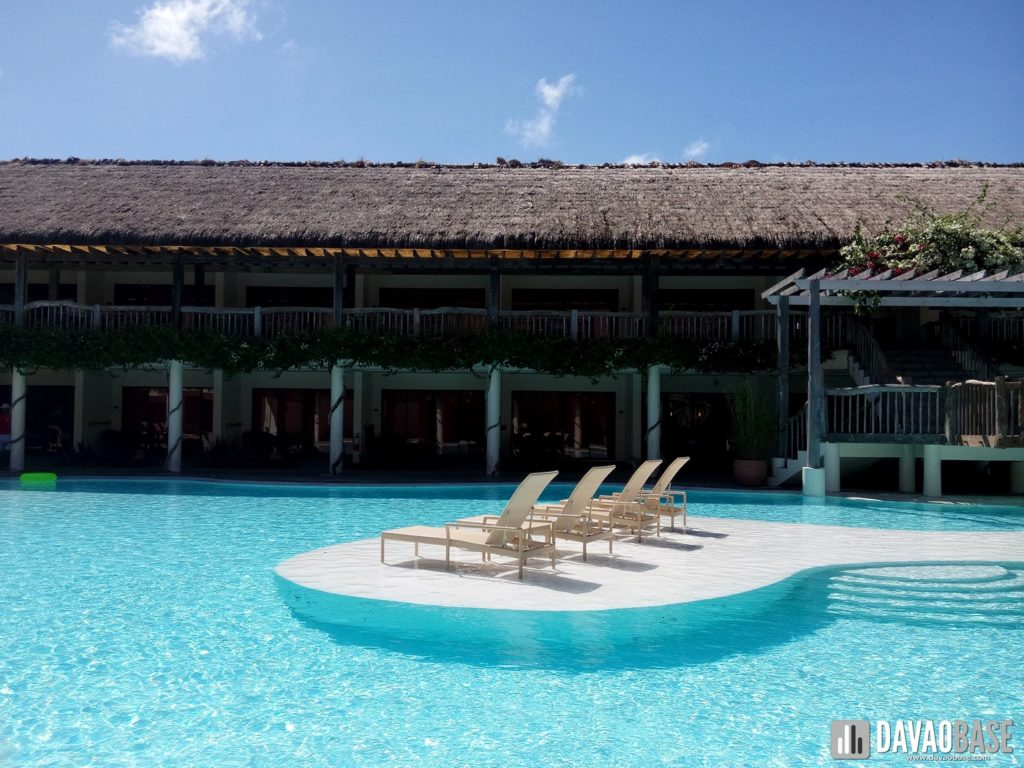 bluewater panglao premier deluxe area swimming pool lounge chairs