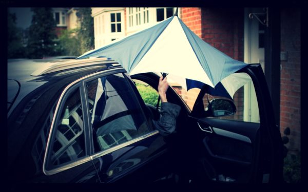 Here's one frustrating umbrella experience: How to get inside the car without getting wet!