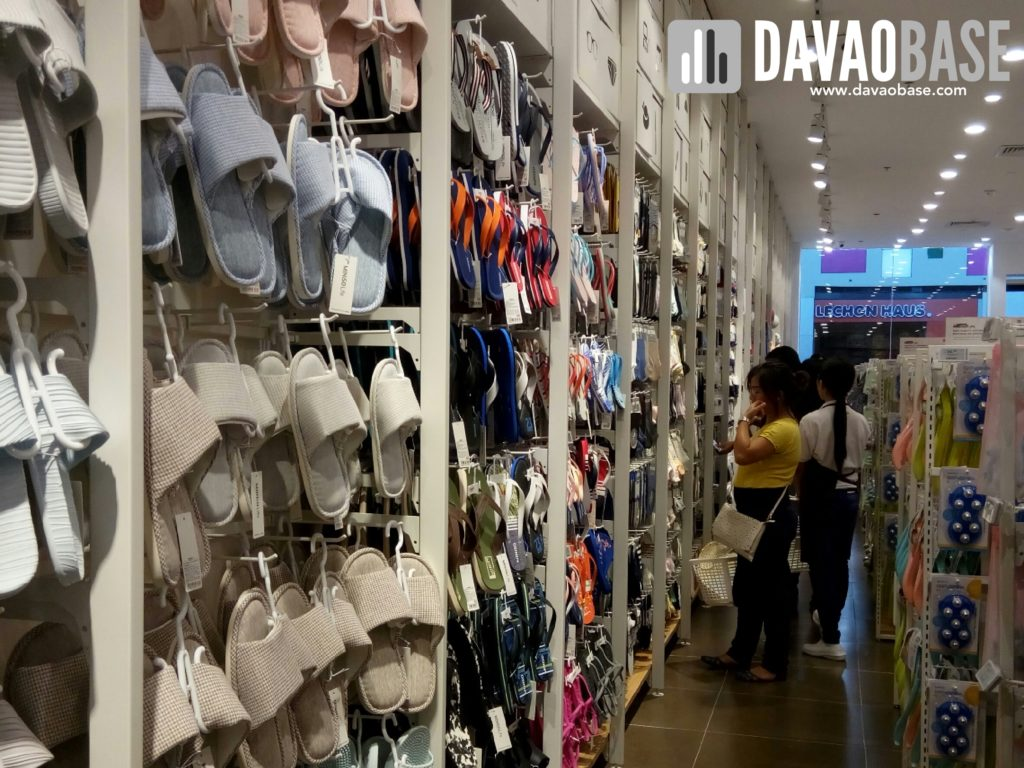 Slippers and sandals on display at Miniso